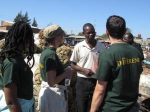 Team LimaLinks getting to know the customer in a Zambian vegetable market.