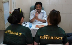Maria and Grace, of Team Janani, interviewing a public health official in India