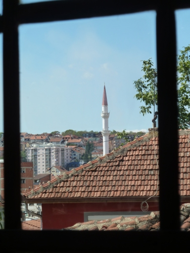 A window overlooking Prishtina, the capital city of Kosovo