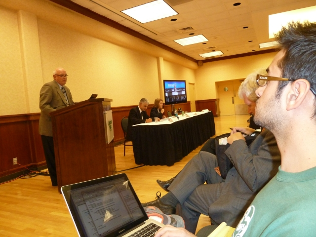 GSSE student Andy Kumar taking notes during Mark Retzloff's presentation at The Global One Health Colloquium