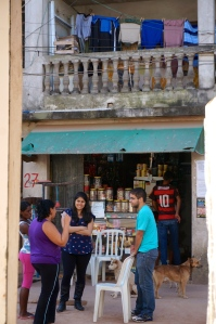 Mariana Negrao having conversations with local residents of a favela.