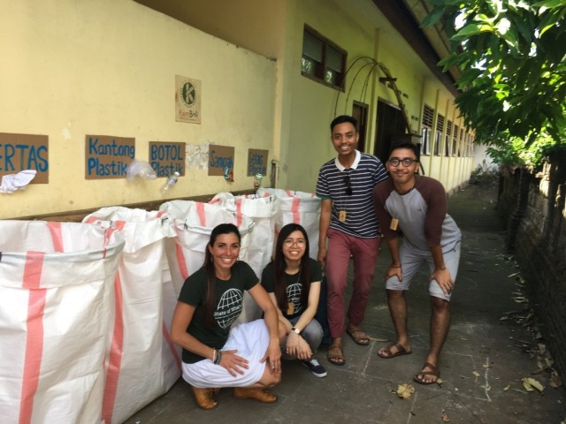 GSSE MBA students Estefania and Maniphet with Green School's local staff in front of the recycling bins they installed at a local primary school in Bali
